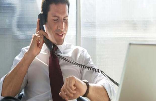 Business man in office, phoning